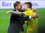 """""""Ich halte es für falsch, dass wir heute Abend spielen: Marco Reus, hier mit Hans-Joachim Watzke."""