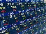 Der Börsen-Tag: Asiens Börsen gehen angeschlagen ins Wochenende