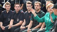 Nach G20-Krawallen: Merkel verspricht mehr Polizei