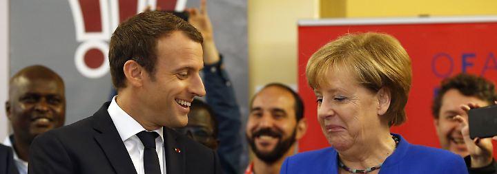 Französisch-deutsche Einigkeit: Merkel und Macron üben Schulterschluss gegenüber Trump