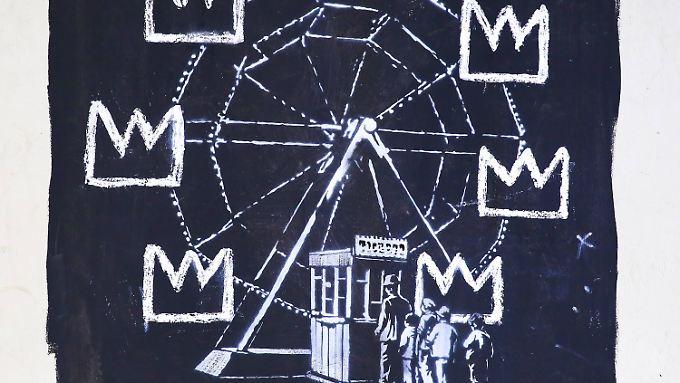 Dieses Bild verspottet möglicherweise die Ausstellung. Kronenmotive, die in einigen von Basquiats Werken auftauchen, ersetzen die Kabinen des Rades.
