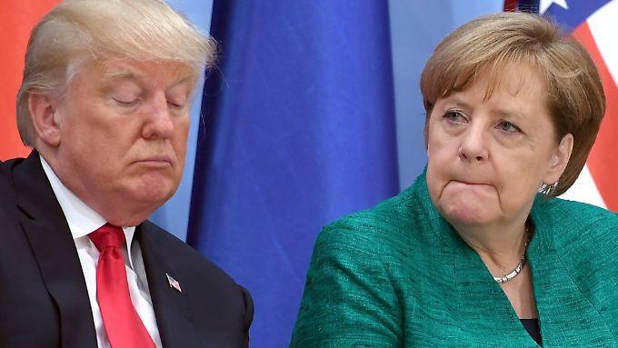 Zu viel zu tun? US-Präsident Donald Trump beglückwünschte Kanzlerin Merkel erst spät zur gewonnenen Wahl.