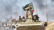 Irakische Truppen nehmen Al-Hawidscha ein.