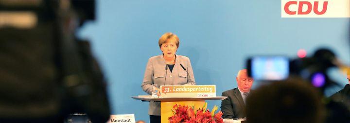 Neuauflage der GroKo?: Merkel und Schulz leisten Überzeugungsarbeit an der Basis