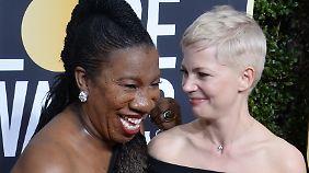 #MeToo-Initiatorin Tarana Burke (l.) an der Seite von Schauspielerin Michelle Williams bei den Golden Globes.
