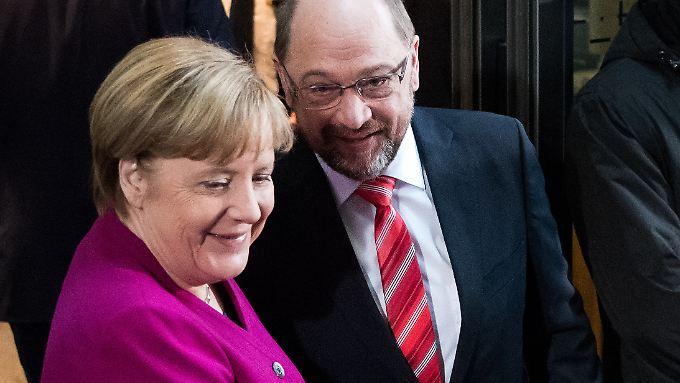 CDU-Chefin Angela Merkel und SPD-Chef Martin Schulz sind sich einig - auch beim Soli.