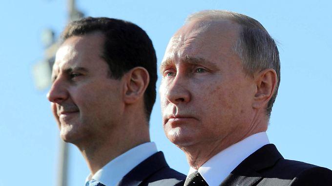 Russland gilt als engster Verbündeter des syrischen Machthaber Assad (l.).