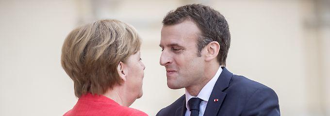 Emmanuel Macron hat große Visionen für die Eurozone. Angela Merkels Unionsfraktion hält dagegen.