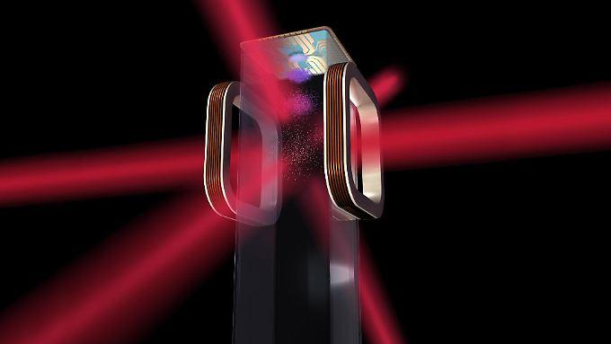 Eine grafische Darstellung des Nasa-Experiments: Ein Chip und eine elektromagnetische Kammer helfen, Atome auf ein milliardstel Grad über dem absoluten Nullpunkt von rund minus 273 Grad Celsius herunterzufrieren.
