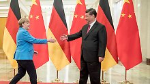 Trotz aller Meinungsverschiedenheiten wollen Angela Merkel und i ihre Kooperation stärken.
