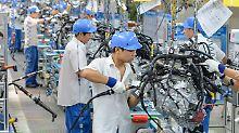 An den hier hergestellten Autos verdient General Motors viel Geld - die Arbeit machen allerdings Chinesen.