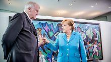 CSU-Chef Seehofer und CDU-Chefin Merkel haben den Asylstreit vertagt. Gelöst ist er nicht.