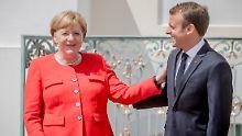 Bundeskanzlerin Merkel ist im Asylstreit mit Innenminister Seehofer auf Frankreichs Hilfe angewiesen.