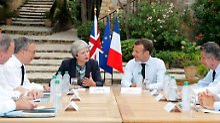 Ist es ein Hilfeschrei?: Mays Besuch bei Macron stößt auf Kritik
