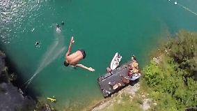 Atemberaubendes am Vierwaldstättersee: Klippenspringer stürzen sich aus 27 Metern ins Wasser