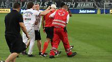 Der Sport-Tag: Nach Becherwurf: Schiedsrichter bricht blutend zusammen
