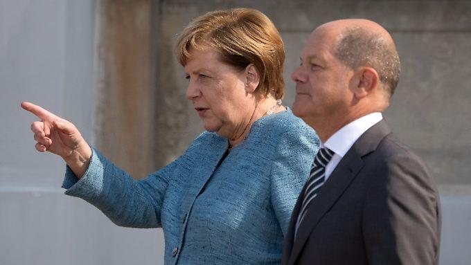 Angela Merkel und Olaf Scholz wollen internationale IT-Konzerne an deutsche Regeln erinnern.