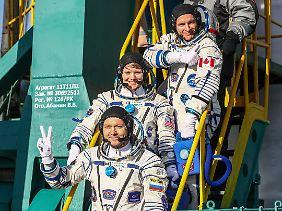 Die neue Crew für die ISS: Oleg Kononenko, Anne McClain und David Saint-Jacques (v.l.)