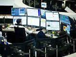 Der Börsen-Tag: 17:38 Dax gibt leicht nach - Bankenwerte mit dickem Plus