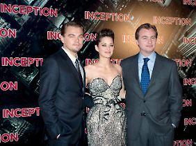 """Der """"Inception""""-Regisseur und seine Stars: Christopher Nolan (r.) mit Marion Cotillard (M) und Leonardo DiCaprio (l.)."""