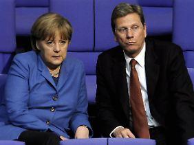Schwarz-Gelb in der Krise: Vor allem die Ergebnisse in Baden-Württemberg dürften für Probleme auch bei Kanzlerin Merkel und ihrem Vize sorgen.