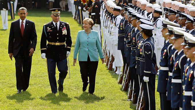 Salutschüsse für die Kanzlerin: Obama empfängt Merkel