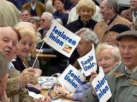 Merkel hat auch jede Menge Anhänger.