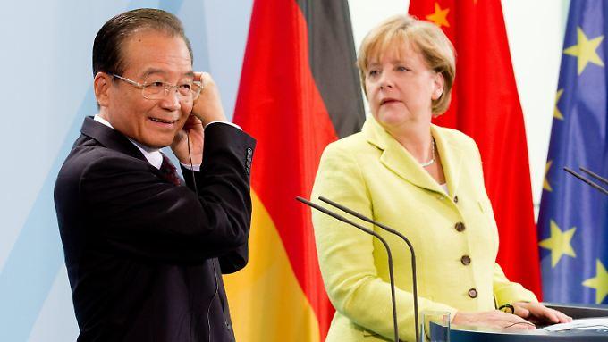 Sehen sich auf dem richtigen Weg, auch, wenn sie nicht immer einer Meinung sind: Chinas Ministerpräsident Wen Jiabao und Bundeskanzlerin Angela Merkel.