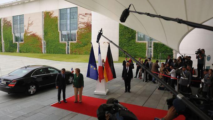 Geballte Aufmerksamkeit: Kanzlerin Merkel und Präsident Sarkozy konnten sich offenbar einigen.