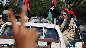 Jubel in Sirte: Rebellen feiern Gaddafis Tod