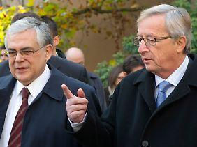 Lukas Papademos und Jean-Claude Juncker wollen die Einführung der Eurobonds.