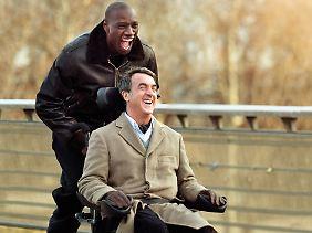 Wie im Märchen, aber aus dem Leben gegriffen. Zwei Männer aus zwei Welten, in unbeschwertem Lachen vereint.