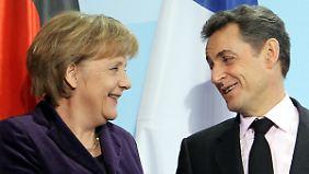 Merkel will Sarkozy im Wahlkampf helfen.