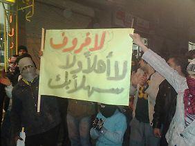 Syrische Demonstranten wenden sich gegen das russische Veto im UN-Sicherheitsrat.