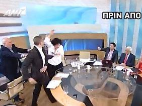 Der Faschist Elias Kassidiaris schlägt im TV-Studio die Kommunistin Liana Kanelli.