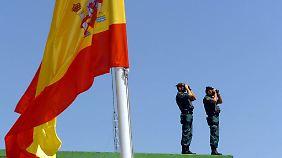 """""""Ein richtiger Schritt"""": Spanien schlüpft unter den Rettungsschirm"""
