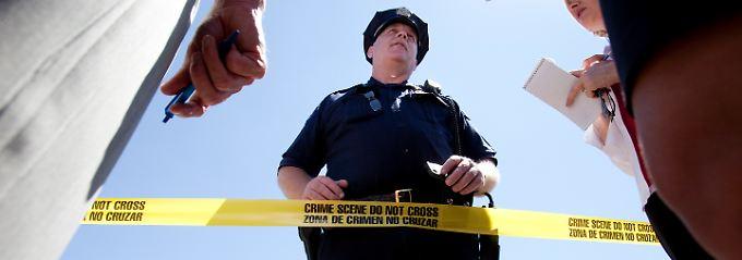 Die US-Presse giert nach weiteren Neuigkeiten über die Bluttat, die sich nur 30 Kilometer entfernt von Columbine zutrug.