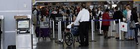 Passagiere auf dem New Yorker Flughafen JFK.