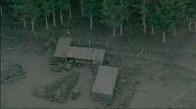 Aschebedeckte Häuser nach dem Ausbruch des Tongariro.