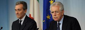 Italiens Finanzminister Grilli (links) und Regierungschef Monti haben die Defizitziele des Landes kassiert.