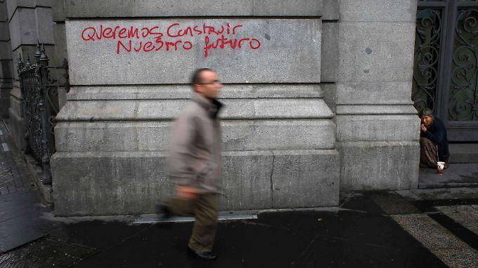 """Graffiti in Madrid: """"Wir wollen unsere Zukunft bauen""""."""