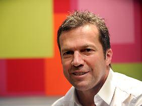 Farblich passt seine Prognose für die WM 2014 schon mal. Lothar Matthäus.