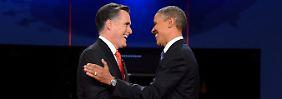 Romney (l.) und Obama nach einem ihrer Fernsehduelle.