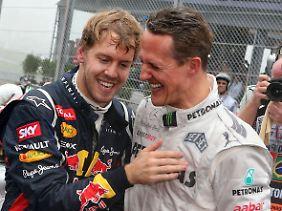 Gratulation vom Rekordchampion: Zur Titel-Bestmarke von Michael Schumacher fehlen Vettel jetzt noch vier WM-Kronen.