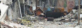 Straßenszene in Homs: Große Teile Syriens sind schwer vom Bürgerkrieg in dem Land gezeichnet.