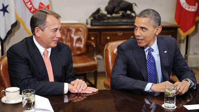Im US-Haushaltsstreit sieht nichts nach einer Einigung zwischen US-Republikanerführer John Boehner (li.) und Präsident Barack Obama (re.) aus.