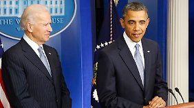 Es war eine lange Nacht für alle, das Land und seinen Präsidenten: Barack Obama (r.).